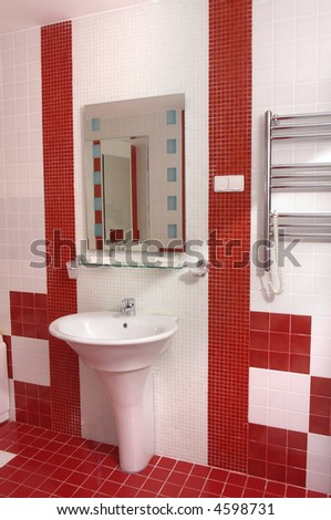 Bath-room in modern hotel in white and red colors