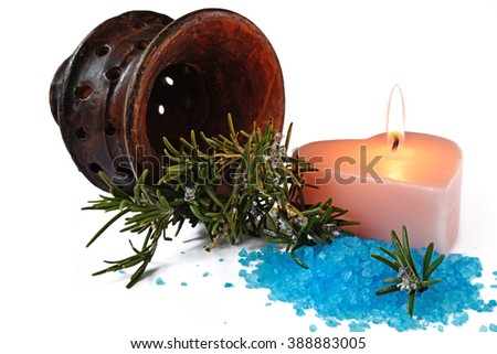 bath salt for relaxing spa with candlelight and container with sprigs of rosemary - stock photo