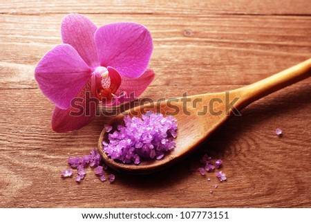 bath salt in a spoon and flowers of orchids - stock photo
