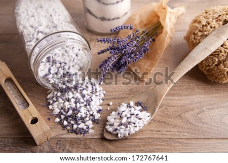 Bath salt with lavender flavour and sponge, thermometer and spoon - stock photo