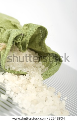 Bath salts are poured out from the green bag
