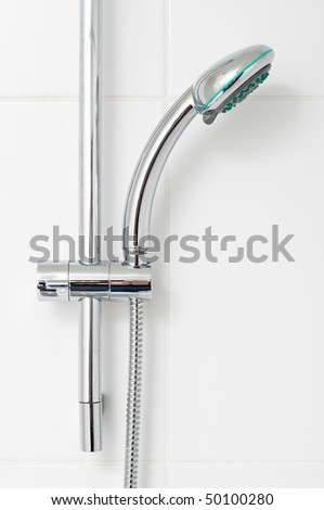 Bath shower on white tile wall - stock photo