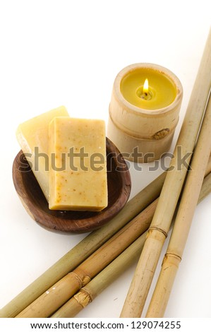 bath soap in bowl, candle ,bamboo on white