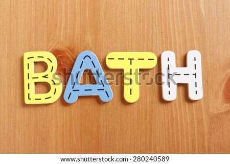BATH, spell by woody puzzle letters with woody background - stock photo