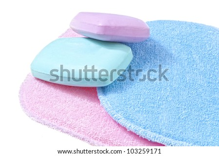 bath sponges in three different colors on white background