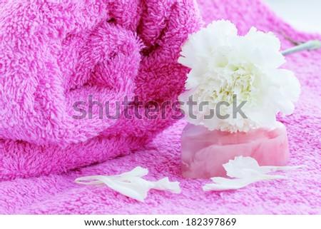 bath still life, towel soap carnation flower - stock photo