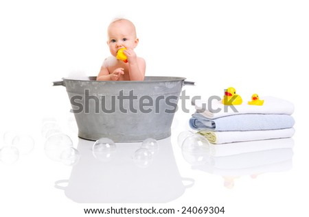 Bath Time. Cute happy baby girl having bath. Isolated on white. - stock photo