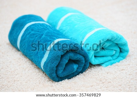 Bath towels on a light background