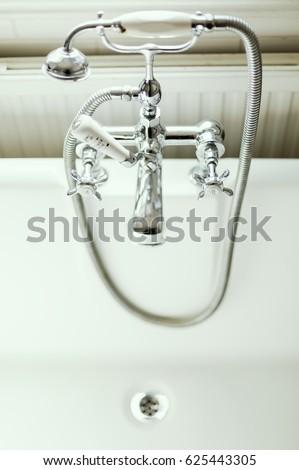 bath tub with shower attachment