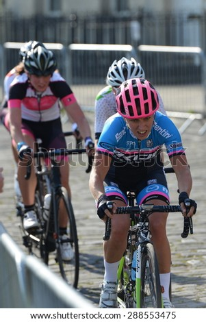 BATH, UK - JUN 11: Cyclists ride in the Pearl Izumi Tour Series bicycle race final on Jun 11, 2015 in Bath, UK. The event drew thousands of spectators to the streets of the picturesque Somerset city. - stock photo