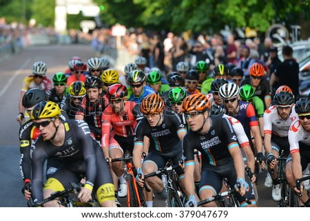 BATH, UK - JUN 11, 2015: The peleton rides in the Pearl Izumi Tour Series bicycle race final. The event drew thousands of spectators to the streets of the picturesque Somerset city. - stock photo