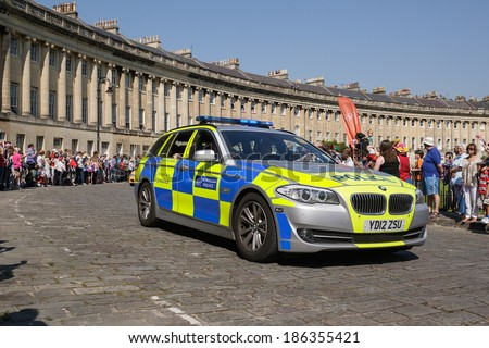 BATH, UK - MAY 22: A Metropolitan police car escort's the 2012 Olympic torch relay as it passes along the Royal Crescent on May 22, 2012 in Bath, UK.  - stock photo