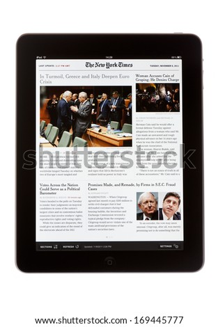 BATH, UK - NOVEMBER 8, 2011: An Apple iPad displaying a digital edition of The New York Times newspaper against a white background. The paper can be downloaded using the Newsstand application for iPad