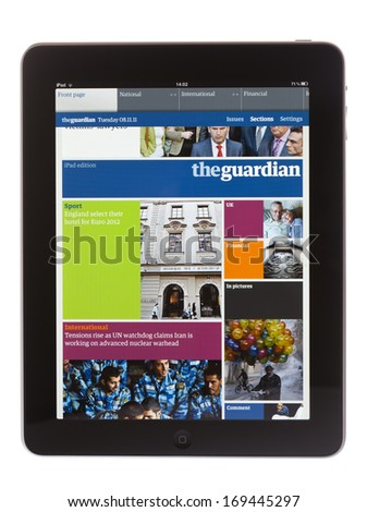 BATH, UK - NOVEMBER 8, 2011: An Apple iPad displaying the iPad edition of the Guardian Newspaper against a white background. The newspaper can be downloaded using the Newsstand application for iPad.