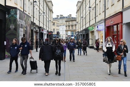 BATH, UK - OCT 18, 2015: People walk on a busy street in Southgate shopping district. The landmark Somerset city has UNESCO World Heritage status and over 4 million visitors a year