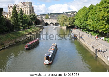 BATH, UK - SEPT 12: Tourists and locals enjoy a day on the River Avon on Sept 12, 2010 in Bath, UK. Bath receives 4.5M visitors a year, with the tourism industry playing a major role in the local economy. - stock photo