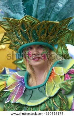 BATH, UNITED KINGDOM - AUGUST 25, 2012: Colorful carnival parade through the streets of Bath, Somerset as part of the celebrations for the London 2012 para olympics - stock photo