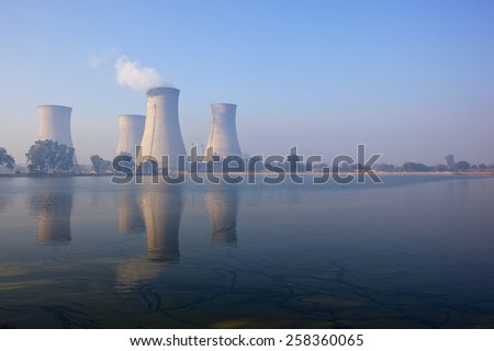 Bathinda, Punjab, India. February 9th 2015.  the cooling towers of Guru Nanak Dev thermal plant reflected in the lake. Bathinda formerly bhatinda after the bhati kings one of Punjab's oldest cities