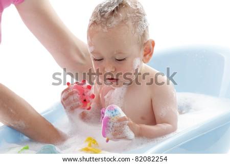 Bathing Baby - stock photo