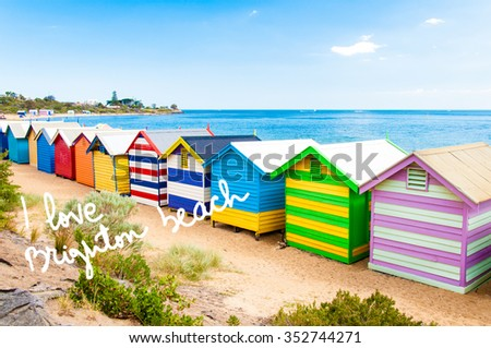 Bathing boxes at Brighton Beach, Australia with hand written text I love Brighton beach