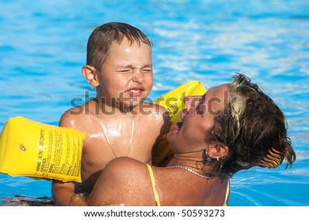 Bathing in pool in the afternoon - stock photo