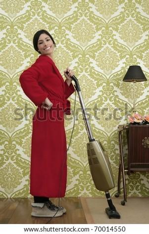 Bathrobe retro housewife woman vacuum cleaner vintage sixties wallpaper - stock photo