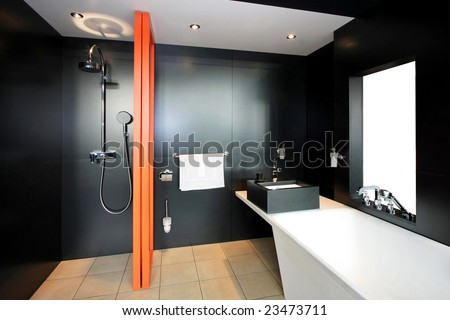 Bathroom all in black with orange divider - stock photo