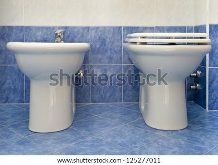 bathroom closeup - the water-closet and bidet. - stock photo