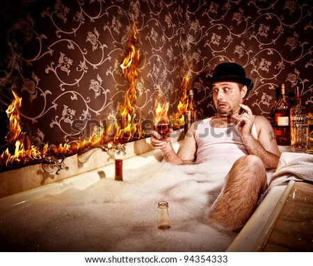 Bathroom Disaster. Fire in the bathroom caused by smoking and drinking - stock photo