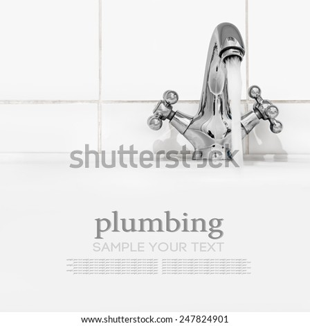 bathroom faucet with running water. Focus on watering can tap - stock photo