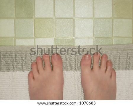 Bathroom feet - stock photo