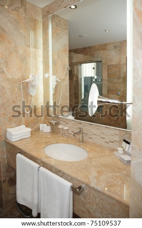 Bathroom in a  hotel - marble basin and mirror