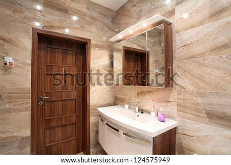 bathroom in luxury home with bath and furniture - stock photo
