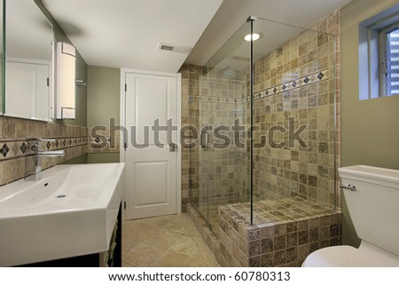 Bathroom in luxury home with glass shower - stock photo