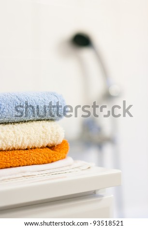 Bathroom interior: closeup of towels folded up on a bathroom cabinet - stock photo
