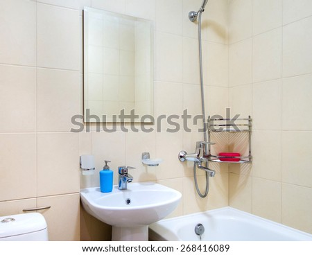 Bathroom interior with a large mirror and washbasin - stock photo