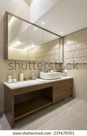 Bathroom interior with large mirror - stock photo