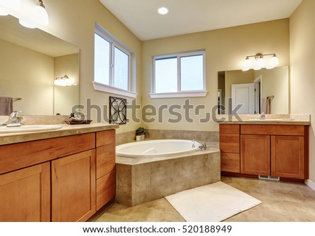 Bathroom interior with two vanities and bathtub in the corner. Northwest, USA