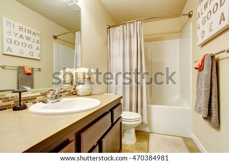Bathroom interior with vanity cabinet and tile floor. Northwest, USA