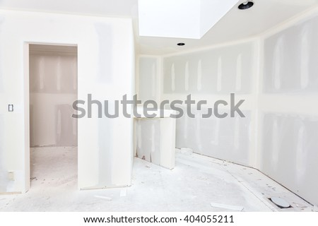 Bathroom remodel progresses as drywall is smoothed, covering seams and screws with tape and spackle (mud) - stock photo