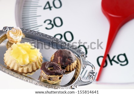Bathroom scale and cake / diet - stock photo