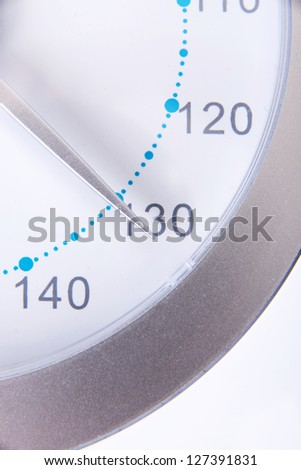 Bathroom scale numbers close up with 130 kg weight - stock photo