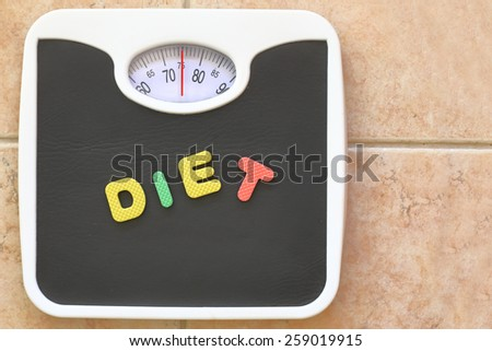Bathroom scale with Diet text. Diet concept - stock photo