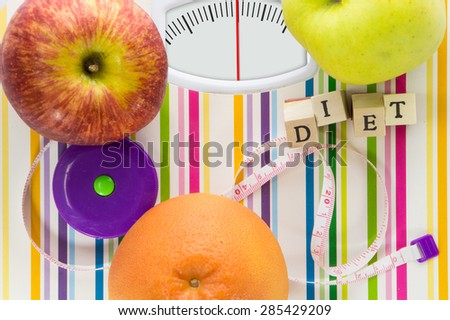 Bathroom scale with fruits and diet text on dial with lines no numbers - stock photo