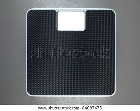 Bathroom scales isolated against a metallic background - stock photo