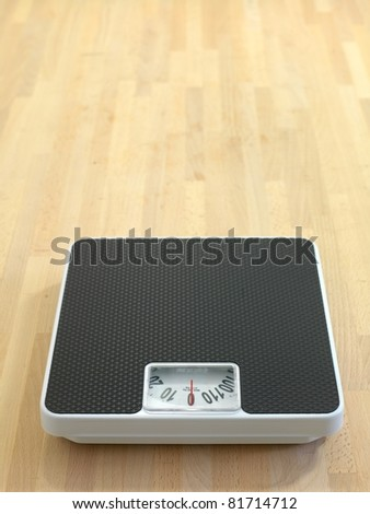 Bathroom scales isolated against a white background - stock photo