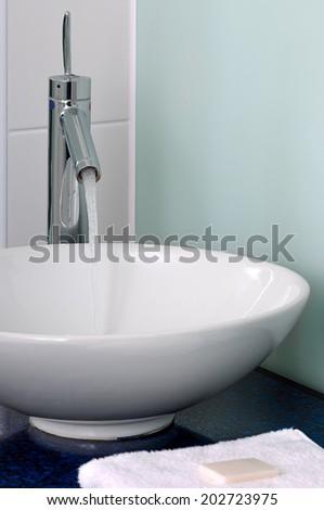 Bathroom sink bowl counter tap mixer towel soap - stock photo