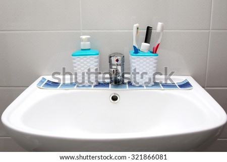 bathroom staff closeup water tap and hygiene objects - stock photo
