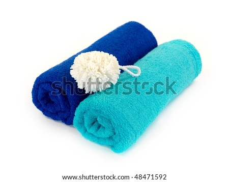 Bathroom towels isolated against a white background