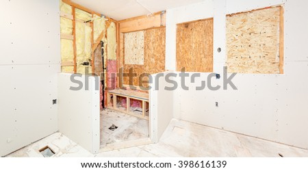 Bathroom walls and shower stall pony walls covered with drywall - stock photo